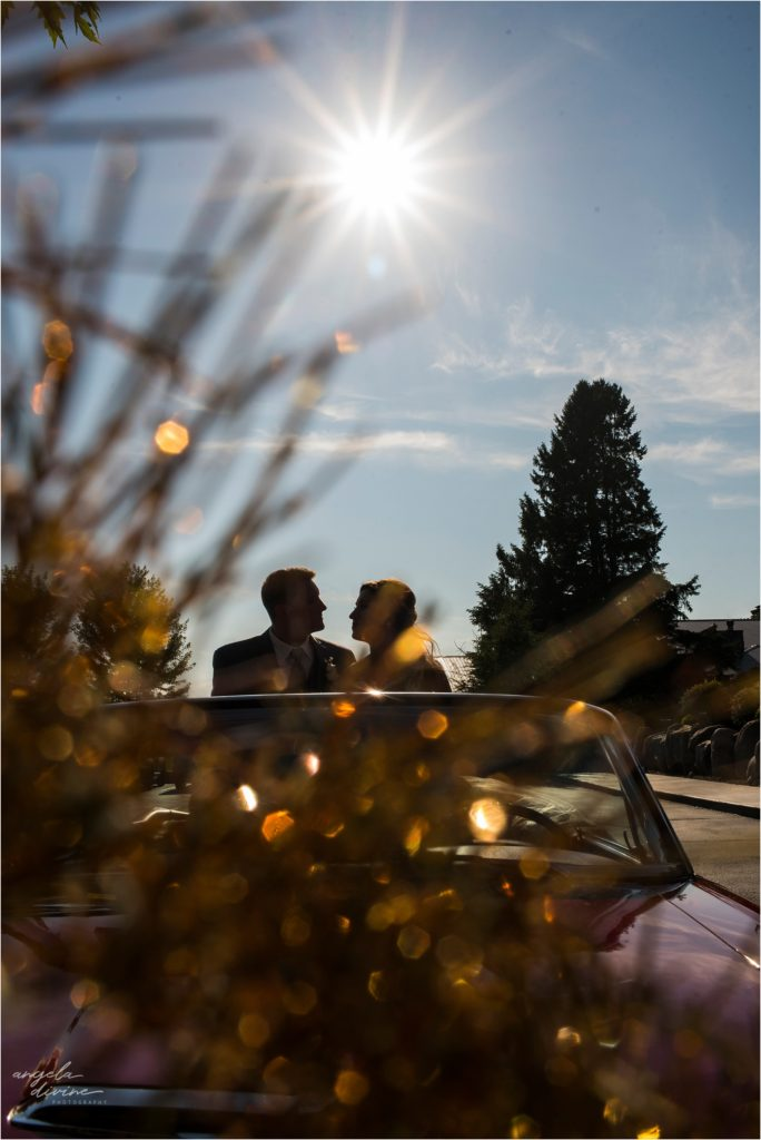 pine peaks event center wedding bride and groom in car