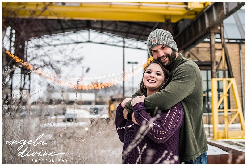 Bauhaus Brew Engagement Session cuddling to stay warm