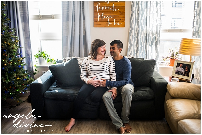Minneapolis lifestyle maternity session sitting on the couch
