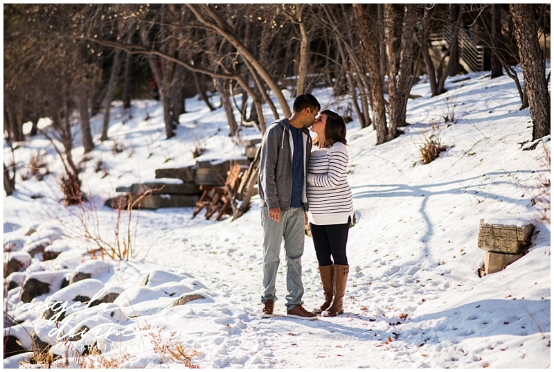 Minneapolis lifestyle maternity session kissing in the snow