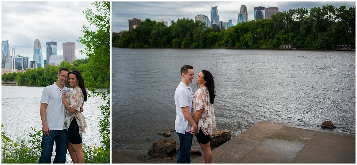 Boom Island Park Engagement posing by the river