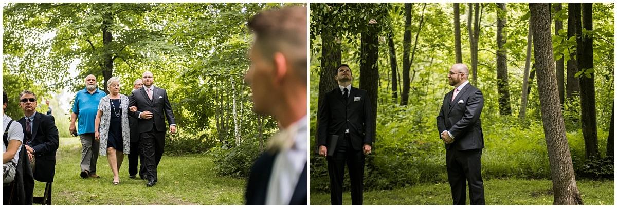 groom escorting mother down aisle