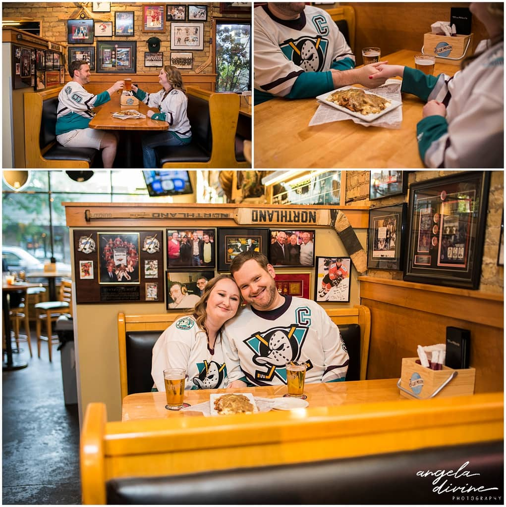 engagement session ideas for Minnesota Wild Fans sharing beer and poutine