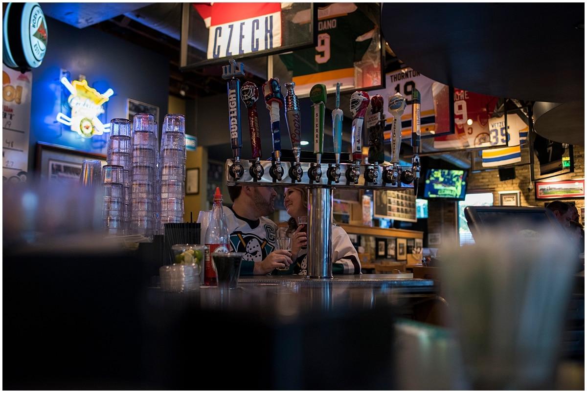 engagement session ideas for Minnesota Wild Fans Tom Reid's bar