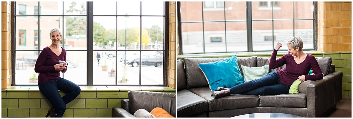 Minneapolis brand photographer for financial coach posing by window