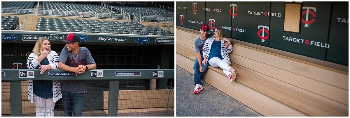 couple posing in baseball stadium