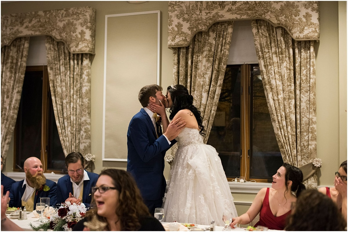 Gale Mansion Christmas Wedding / Beauty and the Beast Themed bride and groom kiss