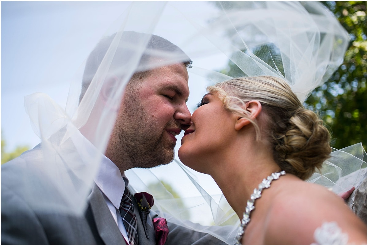 Gardens of Castle Rock Wedding bride and groom kiss