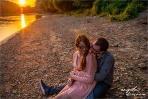 Hidden Falls Engagement Photography sitting on beach at sunset