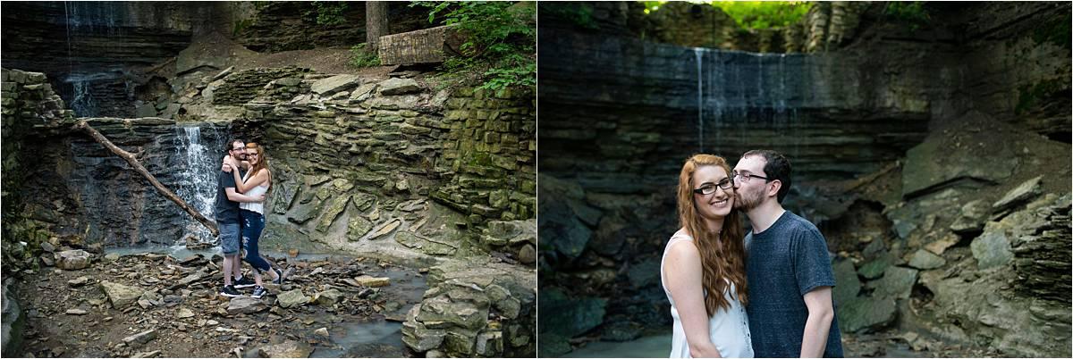 engaged couple posing near waterfall