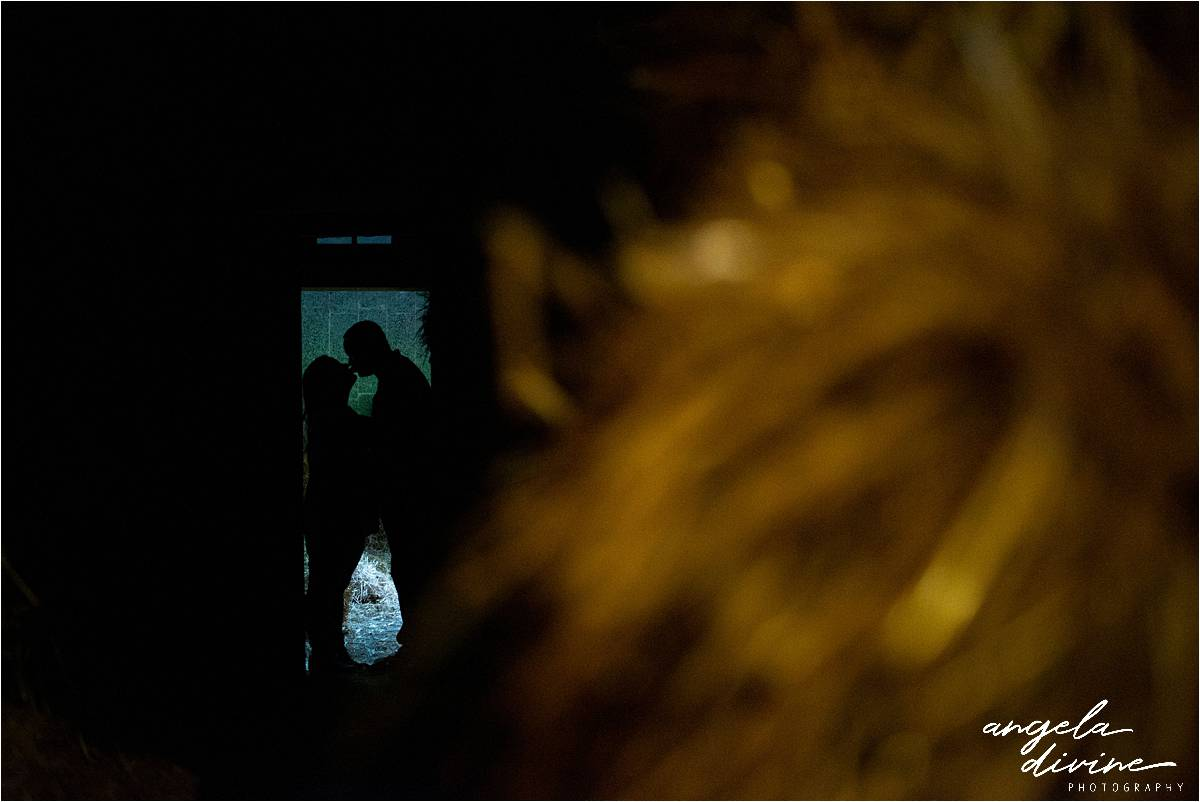 Stillwater Pumpkin Patch Engagement Session stealing a kiss in the barn